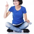Student woman pointing on copy space. — Stock Photo