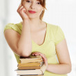 Young caucasian woman with books — Stock Photo #12635505