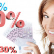 Happy woman holding euro money against percentage — Stock Photo