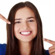Teen girl pointing on her perfect teeth — Stock Photo