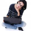 A young woman with a laptop sitting — Stock Photo #13266455