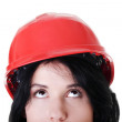 Confident female worker in helmet looking up — Stock Photo #13266503