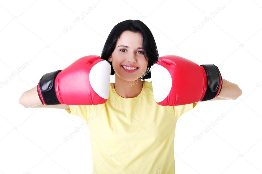 Young woman wearing a pair of boxing gloves. Student woman ready for exams  — Stock Photo #13266596