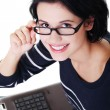 Happy young woman using her laptop — Stock Photo #14918619