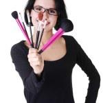 Make-up artist holding brushes — Stock Photo
