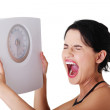Frustrated woman with scale — Stock Photo #14921831