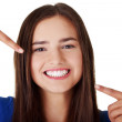 Teen girl pointing on her perfect teeth — Stock Photo #15966913