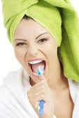 Happy teen girl singing to tooth brush — Stock Photo