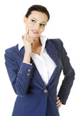 Young thoughtful businesswoman looking on side — Stock Photo