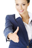 A beautiful businesswoman about to shake hands. — Stock Photo