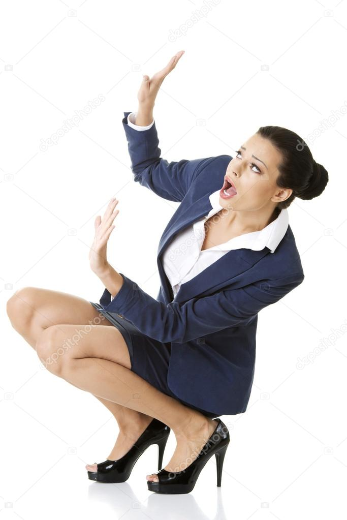 Scared businesswoman defending herself, isolated on white background — Stock Photo #15996181