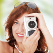 Woman holding a micro four thirds photo camera. — Stockfoto