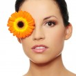 Attractive girl without a make-up, with flower on eye — Stock Photo #16275793