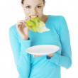 Fit young beautiful woman eating salat — Stock Photo #16935589