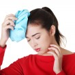 Woman with ice bag for headaches and migraines — Stock Photo