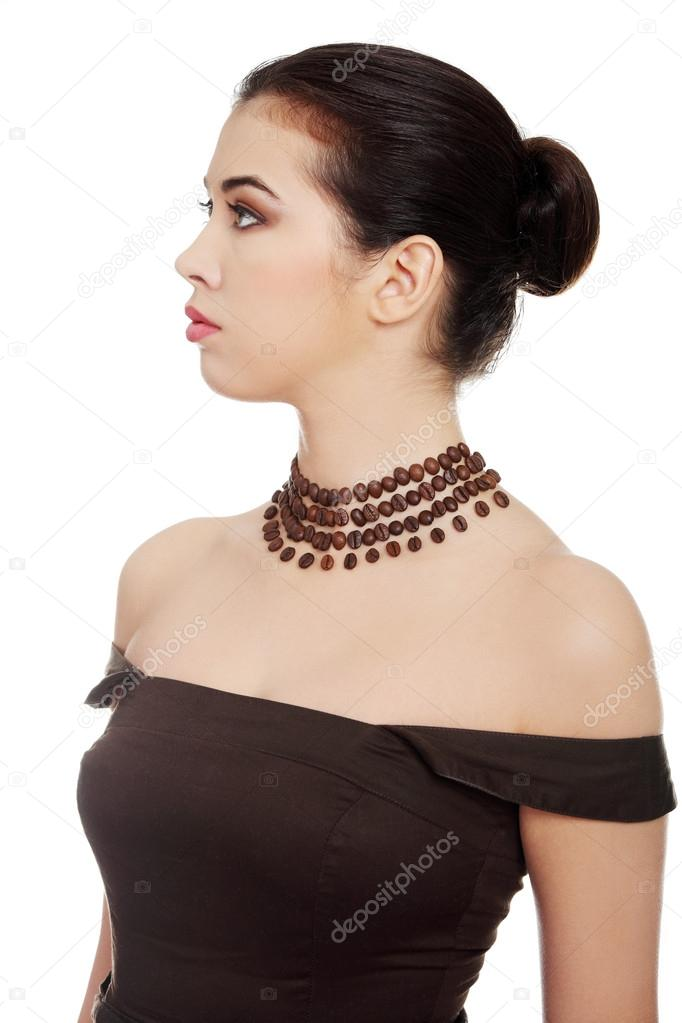 Beautiful elegant young woman with necklace made frome coffee beans, isolated on white — Stock Photo #18359977