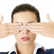 Attractive businesswoman covering her eyes — Stock Photo #19395683