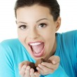 Woman with hand full of chocolates — Stock Photo