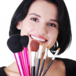 Young make-up artist woman holding brushes — Stock Photo #19396377