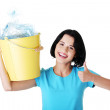 Woman carrying a container with empty recyclable plastic. — Stock Photo #19397441
