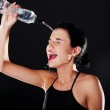 Sport woman cooling herself with water — Stock Photo