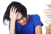 Sad female student with learning difficulties — Stockfoto