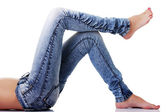 Fit female body in blue jeans — Stock Photo