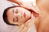 Relaxed woman enjoy receiving face massage — Stock Photo