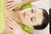 Woman relaxing beeing massaged in spa saloon — Stock Photo