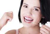 Beautiful woman using dental floss — Foto Stock