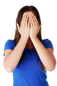 Teen woman covering her face — Stock Photo