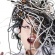 Troubled businesswoman with cables on head — Stock Photo #23436866
