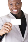 Businessman with blank business card — Stock Photo