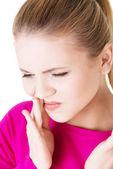 Teen woman having a terrible tooth ache. — Stock Photo