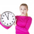 Shocked woman with clock — Stock Photo #23974037