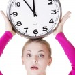 Stock Photo: Shocked woman with clock