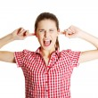 Young angry teen clogging her ears — Stock Photo #24594815