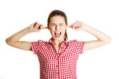 Young angry teen clogging her ears — Stock Photo
