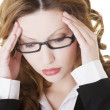 Businesswoman with a headache holding head — Stock Photo