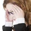 Businesswoman with a headache holding head — Stock Photo #24902813