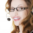 Royalty-Free Stock Photo: Beautiful call-center assistant smiling