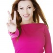 Woman showing victory sign — Stock Photo