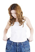Happy fit woman with big pants — Stock Photo