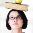 Student with an apple and book — Stock Photo