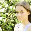 Beautiful young woman in blooming garden — Stock Video #27350909