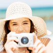 Summer woman talking pictures with digital camera — Stock Photo #27554339