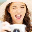 Summer woman talking pictures with digital camera — Stock Photo #27554359