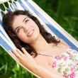 Young woman lying in a hammock — Stock Photo