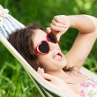 Young woman lying in a hammock — Stock Photo #27554769