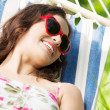 Young woman lying in a hammock — Stock Photo #27554857